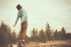 Young Man Flying Levitating or Jumping Outdoor Relax Lifestyle H